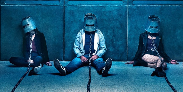 Saw: Legacy (2017) From left to right: Mitch (Mandela van Peebles), Anna (Laura Vandervoort), Ryan (Paul Braunstein), Carly (Brittany Allen), and Buckethead NOTE* the identity of the buckethead on the far right is a big reveal in the film, so they will not ID him